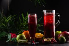 Lemonade blueberry - blackberry in a jug and a glass and fruit stock photos
