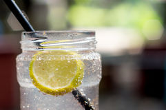Lemonade bottle with straw Stock Photos