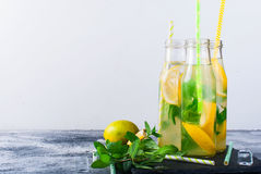Lemonade in bottles with ice and mint Royalty Free Stock Photography