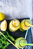 Lemonade in bottles with ice and mint Royalty Free Stock Photo