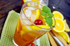 Lemonade with cherry in glassful on board Stock Photos