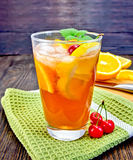 Lemonade with cherry in glassful on dark board Royalty Free Stock Image