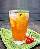 Lemonade cherry and orange in glassful on board Royalty Free Stock Photo