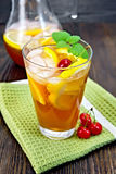 Lemonade cherry and orange in glassful on dark board Stock Images