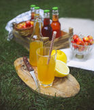 Lemonade with cherry, pear and lemon on the garden picnic Royalty Free Stock Images