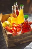 Lemonade with cherry, pear and lemon on the garden picnic Royalty Free Stock Image