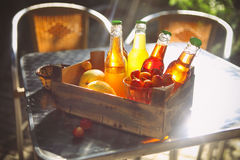 Lemonade with cherry, pear and lemon in the wooden box Royalty Free Stock Image