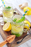 Lemonade with citrus and ginger Stock Images