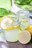 Lemonade. Country cold fresh lemonade on table Royalty Free Stock Images