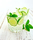 Lemonade with cucumber and mint on board Royalty Free Stock Photography