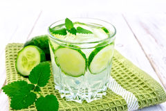 Lemonade with cucumber and mint in glassful on board Royalty Free Stock Images