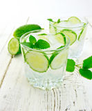 Lemonade with cucumber and mint on light board Royalty Free Stock Image