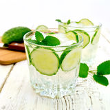 Lemonade with cucumber and mint in two glassful Stock Image