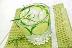 Lemonade with cucumber and rosemary in glassful on board Royalty Free Stock Photos