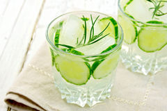 Lemonade with cucumber and rosemary in two glassful on beige nap Stock Images