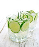Lemonade with cucumber and rosemary in two glassful on table Royalty Free Stock Images