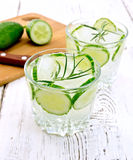 Lemonade with cucumber and rosemary in two glassful on white boa Stock Photo