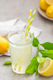 Lemonade. Drink with fresh lemons. Lemon cocktail with juice. Royalty Free Stock Photo