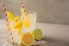 Lemonade. Drink with fresh lemons and limes. Summer mood, Lemon cocktail with juice and ice.  royalty free stock photo