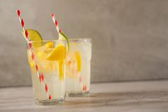Lemonade. Drink with fresh lemons and limes. Summer mood, Lemon cocktail with juice and ice. Refreshing drink.  stock photos