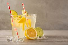 Lemonade. Drink with fresh lemons and limes. Summer mood, Lemon cocktail with juice and ice. Refreshing drink royalty free stock photo