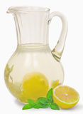 Lemonade. A drink of lemon and mint in glass jug isolated on white background Royalty Free Stock Photos