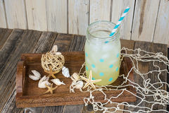 Lemonade drink with seashells Royalty Free Stock Image