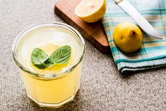Lemonade drink of soda water with mint leaves and lemon. Royalty Free Stock Photos
