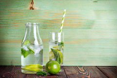 Lemonade drink on a wooden background Royalty Free Stock Image