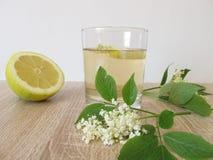 Lemonade with elderflower and lemon stock image