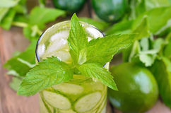 Lemonade with fresh cucumber, lime and mint in glass. Close up view Stock Photography