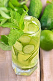 Lemonade with fresh cucumber, lime and mint in glass Royalty Free Stock Images