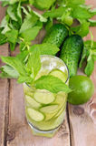 Lemonade with fresh cucumber, lime and mint in glass Stock Image