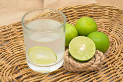 Lemonade with fresh green lemon Royalty Free Stock Photography