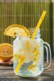 Lemonade with Fresh Lemon. Healthy Food and Drink Concept. Lemonade with Fresh Lemon on Wooden Background. Healthy Food and Drink Concept Stock Photos