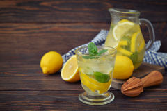 Lemonade with fresh lemon Stock Images