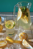 Lemonade with fresh lemon and mint Stock Photos