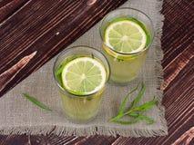 Lemonade. With fresh lemon on wooden background Royalty Free Stock Images