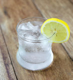Lemonade with fresh lemon on wooden Royalty Free Stock Photography