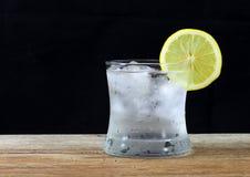 Lemonade with fresh lemon on wooden Royalty Free Stock Photo