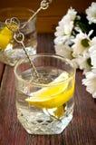 Lemonade with fresh lemon on wooden background Stock Photo