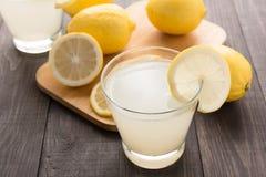 Lemonade with fresh slice lemon on wooden table Stock Photo