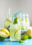 Lemonade in glass bottle with ice and mint Royalty Free Stock Images