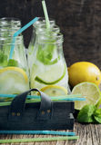 Lemonade in glass bottle with ice and mint Royalty Free Stock Photos