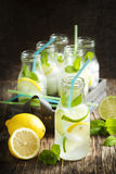 Lemonade in glass bottle with ice and mint Royalty Free Stock Photography