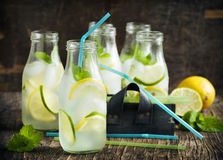 Lemonade in glass bottle with ice and mint Stock Photography