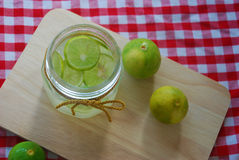 Lemonade in glass container Royalty Free Stock Photo