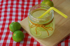 Lemonade in glass container Royalty Free Stock Photography