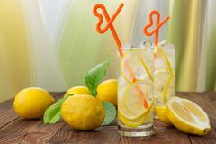 Lemonade in a glass with ice. Stock Photo