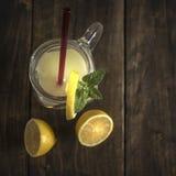Lemonade glass jar with lemon wedges and straw Royalty Free Stock Photos